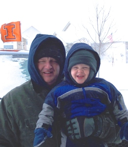 My son and grandson, helping me with some winter grilling a few seasons ago!